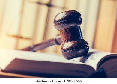 Court hammer laying on book. Justice, trial and law symbol. Judgment.