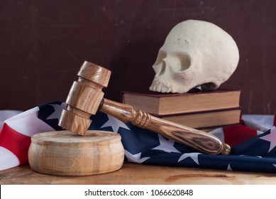 A court hammer and a skull on the background of the flag of the United States, the death penalty, the Federal court of the United States