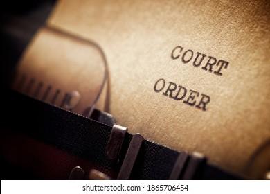 Court order phrase written with a typewriter.