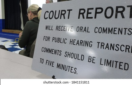 Court reporter at public hearing