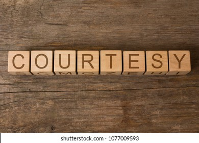 courtesy word written on wooden toy cubes