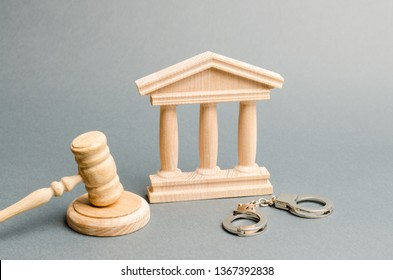 Courthouse and handcuffs. The concept of the court. Verdicts in criminal cases. Justice. The judicial system. Legal power. Criminal Code. Repression and persecution of activists and oppositions.