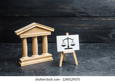 Courthouse and a sign with scales. The concept of the court and the judiciary, justice. Respect for the rights of man and citizen, the resolution of conflict situations and the issuance of verdicts.