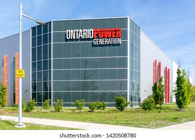 Courtice, Ontario, Canada-June 09, 2019: Sign of Ontario Power Generation on the building at Darlington Energy Complex in Courtice, Ontario, the building supporting refurbishment reactors.