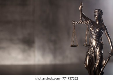 Courtroom concept. Blind justice, mallet of the judge. Gray stone background. Place for typography.