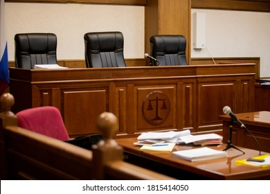 A courtroom in a Russian court, an empty judge's chair