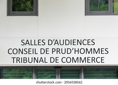 Courtrooms, labour court and commercial court building on a wall in France called salles d'audiences, conseil de prud'hommes, tribunal de commerce in french language