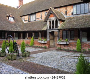 Courtyard area of Ancient English Alms Houses with well in centre
