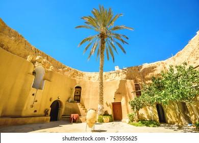 Courtyard of berber underground dwellings. Matmata, Tunisia, North Africa