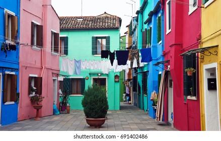 Courtyard between houses on the island of Burano, Italy