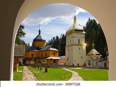 Courtyard of christian monastery (Manjava village, Ivano-Frankivsk Region, Ukraine) view through the entrance gate arch