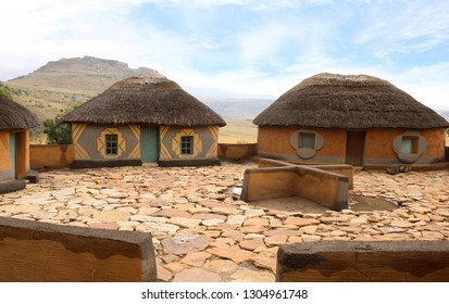 Courtyard with cruciform cooking place. Clay rondavels with straw roof. Basotho village. South Africa. Traditional tribal lifestyle. Ethnic houses surrounded by the wild untouched nature.