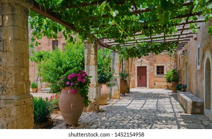 Courtyard with grapevines and flower pots at Arkadi Monastery near Rethymno, Crete