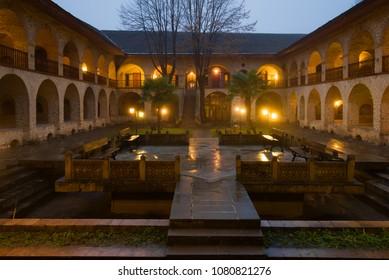 The courtyard of the Great Caravansary was raining January evening. Sheki, Azerbaijan