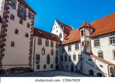 Courtyard of the high castle of the city fuessen with paintings of oriels and windows with three-dimensional effect