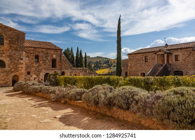 Courtyard of the old Abbey of Sant Antimo is a former Benedictine monastery in the comune of Montalcino, Tuscany, Italy