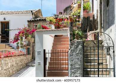 Courtyard with stairs and plants in Taormina at Sicilian Island, Italy