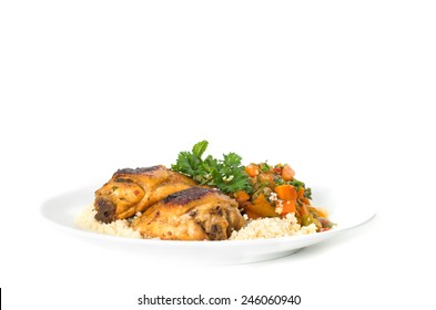 Cous cous Kabylia with chicken and vegetables against white background