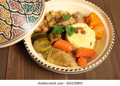 Couscous in a clay pot with drawings