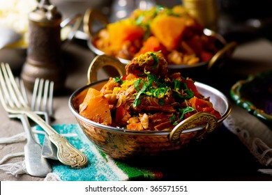 couscous with meat and vegetables in copper east  bowl. ethnic style. selective focus