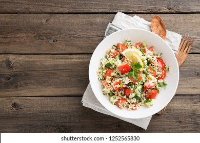 Couscous with parsley, tomato, lemon and olive oil. Traditional Arabic Salad Tabbouleh. top view
