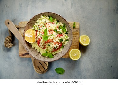 Couscous with parsley, tomato, lemon and olive oil. Traditional Arabic Salad Tabbouleh
