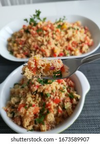 Couscous salad with vegetables and grilled chicken breast