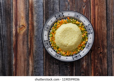 Couscous in traditional moroccan dish, copy space.