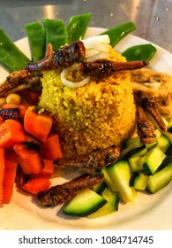 Couscous with vegetables and locusts