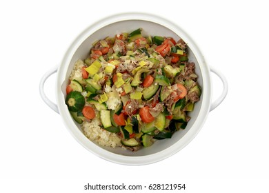 Couscous with vegetables in a white bowl