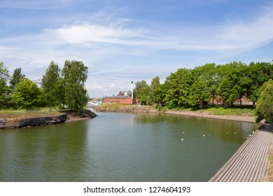 Cove at the pier in the historic fortress island Suomenlinna, Sveaborg in the Gulf of Finland in Finland on a summer day.