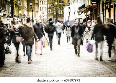 COVENT GARDEN, LONDON- 30 DECEMBER 2016: Busy high street with many shoppers carrying shopping bags.
