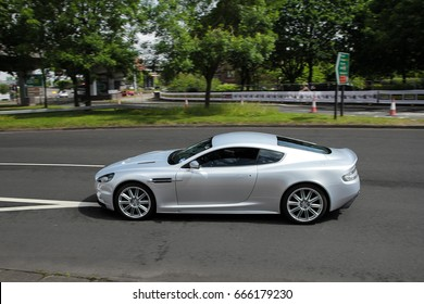 Coventry, England - 04.06.17: Aston Martin DBS supercar completing a sprint circuit at a motor festival in Coventry. The circuit consists of a few major roads on the outskirts of Coventry.