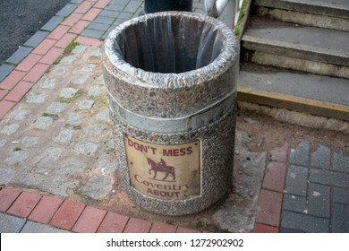 Coventry, England - December 24, 2018 - Warning brown placard 'Don't mess Coventry about' with the image of Lady Godiva riding on a horse posted on outdoor garbage bin