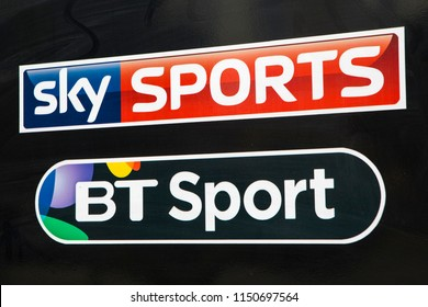 COVENTRY, UK - JULY 26TH 2018: A close-up of the logos for Sky Sports and BT Sport, pictured on a public house sign, on 26th July 2018.