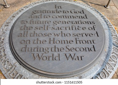 Coventry, UK - July 26th 2018: A plaque inside the ruins of the old Coventry Cathedral commemorating the self-sacrifice of those who served on the Home Front during the Second World War.