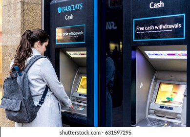 Coventry, UK - March 18, 2017: Pregnant woman making cash withdraw from Barclays Bank in Coventry, UK