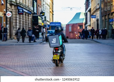 Coventry, UK - November 17, 2018: Deliveroo, Food Delivery motor bike driver in Coventry City Centre,  busiest time of the day evening for Delivery.