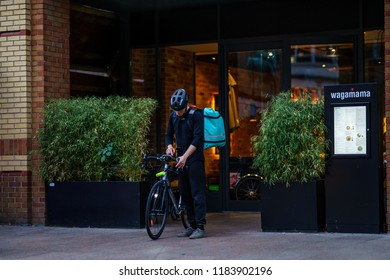 Coventry, UK - September 13th, 2018 : Coventry Town Centre DELIVEROO Currier is setting Navigation for serving food from Restaurant to Customer.