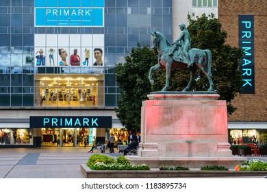 Coventry, UK - September 14th, 2018 : Coventry Town Centre Lady Godiva Statue with Primark Building
