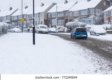 COVENTRY, UNITED KINGDOM 10-12-2017: heavy snowfall, cars covered by snow and traffic affected.