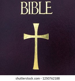 The cover of a Catholic Bible. It has a golden Christian cross in the front