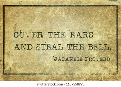 Cover the ears and steal the bell - ancient Japanese proverb printed on grunge vintage cardboard