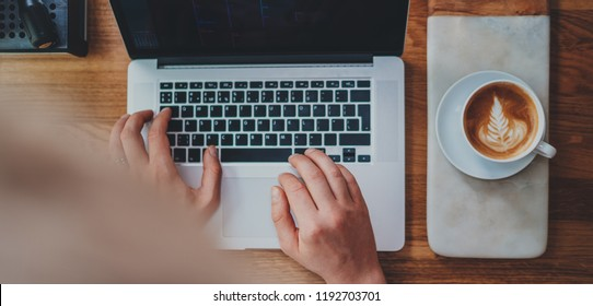 Cover image for website, top view of professional businessman working in loft on modern portable computer, coffee shop owner using laptop for checking the graph to analyze the marketing plan