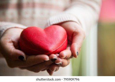 Cover red heart with your hands.