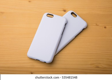 Cover for smart phone on rustic wooden background