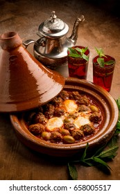 cover and tajine with meat balls eggs and green olives
