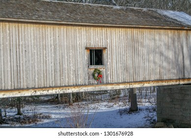 covered bridge during Christmas with snow and wreath in Connecticut (Comstock Bridge East Hampton CT)