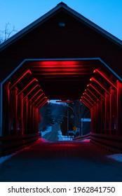 Covered bridge at dusk at Coaticook Gorge Park during winter