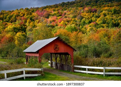 Covered bridge surrounded by fall color in the countryside of Vermont, USA